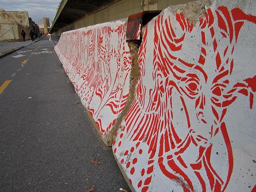 Art on Jersey barriers in Brooklyn.
