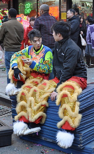 Young men in costume at Lunar new Year celebration.