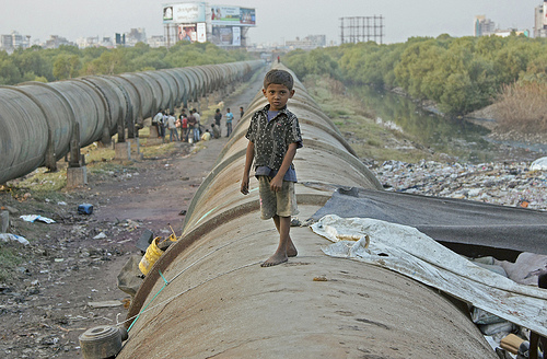 Little Indian boy on a pipe.