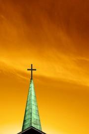 Green cross against orange sky