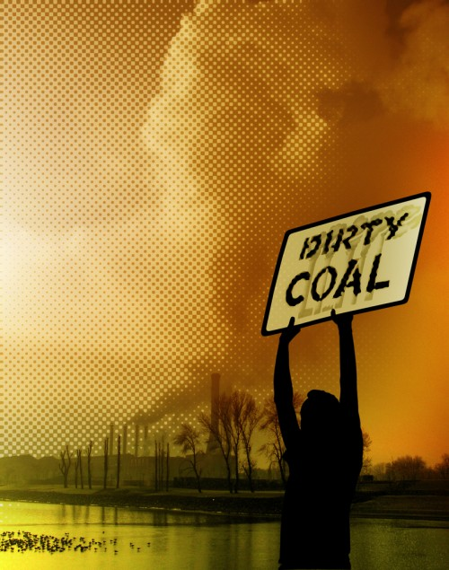 "woman holding ""dirty coal"" sign"