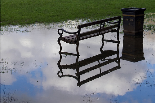 Bench in a puddle.