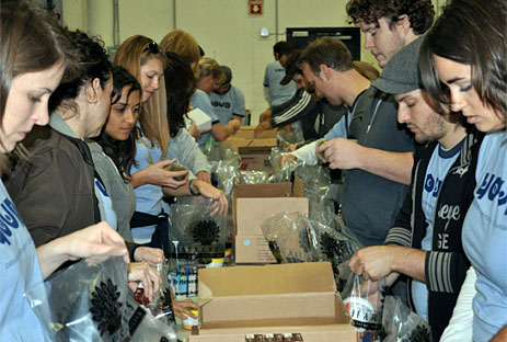Volunteers packing food