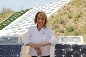 Gabrielle Giffords with solar panels