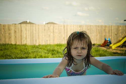 Girl by swimming pool