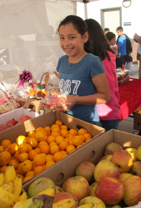 Ceres kids buying fruit at stand