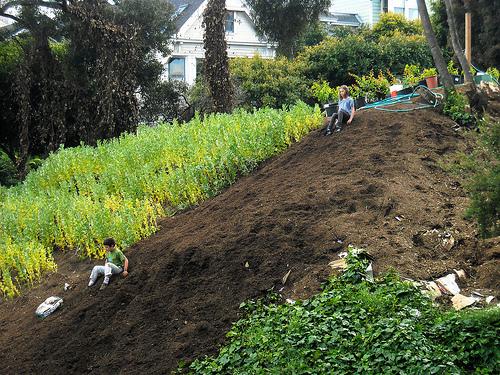 Kids sliding on dirt