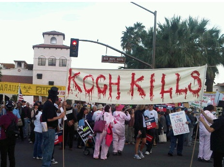 protest sign at anti-koch march in Palm Springs