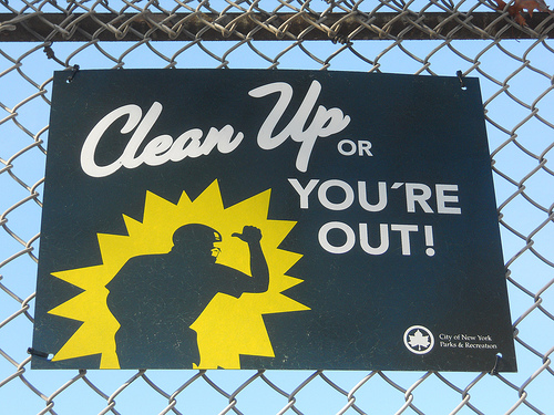 Clean up or you're out sign.