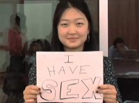 """young woman holding """"i have sex"""" sign"""