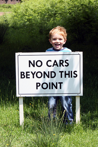 Kid with no car sign