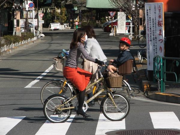 Woman on bike in Tokyo.