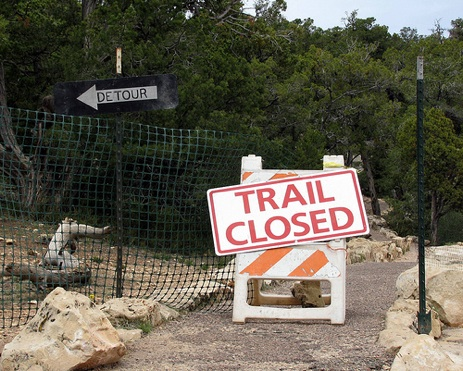 """trail closed"" sign"