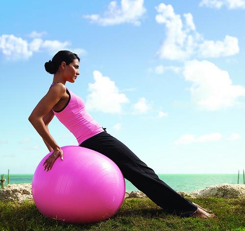 Woman on a vinyl ball.