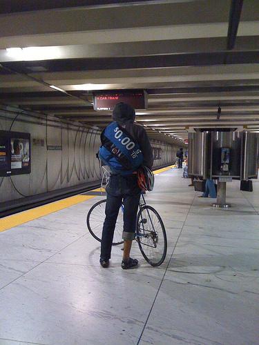 guy w/ bike, zero per gallon sign