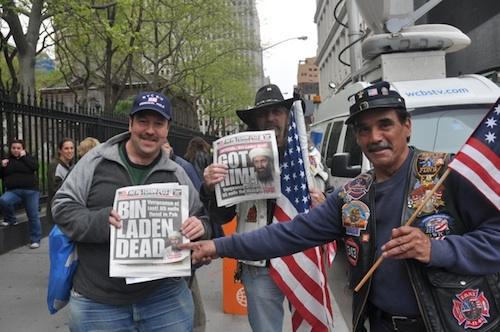 Guys with Osama bin Laden headlines.