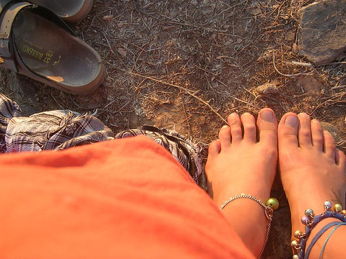 Birkenstocks and feet.