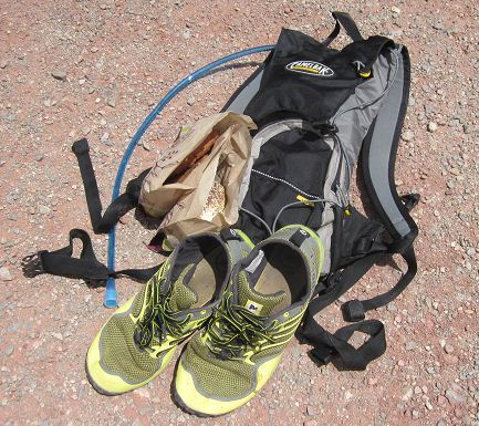 Camelbak and running shoes