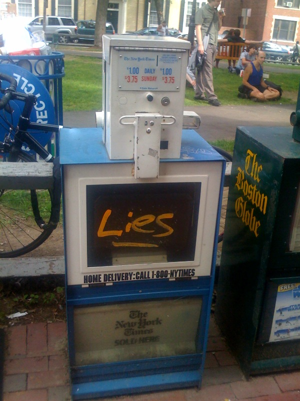 Lying newspaper box