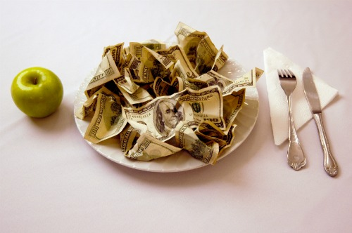 pile of money on a plate