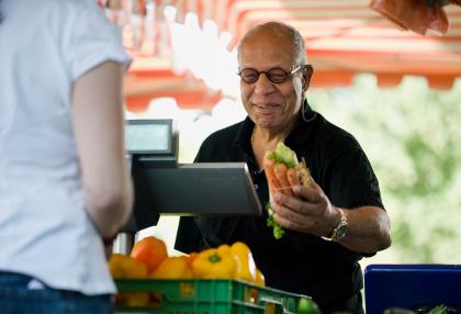 Man buying produce.
