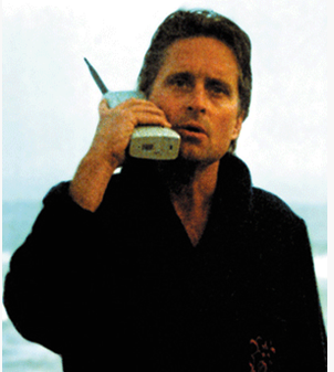 "Michael Douglas on huge cell phone in ""Wall Street"""
