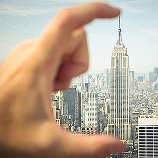 Pinching a skyscraper.