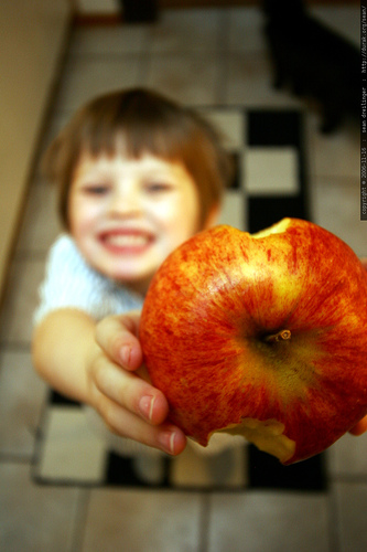 Kid with an apple.