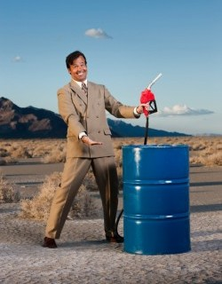 smiling man with oil barrel