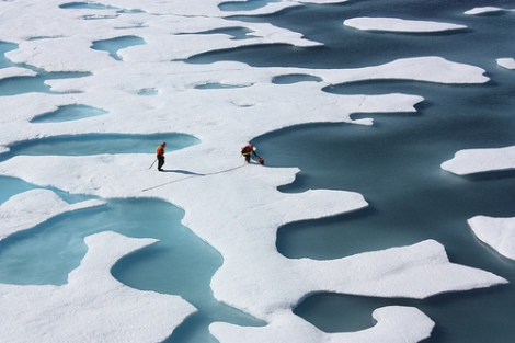 Ponds on the surface of Arctic ice. (Photo by NASA.)