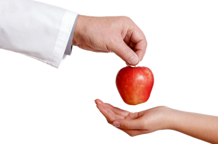 Doctor with apple.