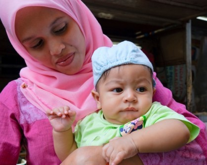 mother in headscarf and child