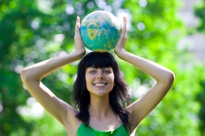 happy woman holding globe