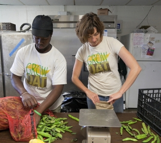 Johanna Gilligan packs fava beans with a student from the Grow Dat program in New Orleans.