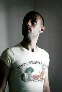 "man with ""100% vegetarian"" T-shirt"