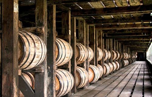 barrels of aging bourbon