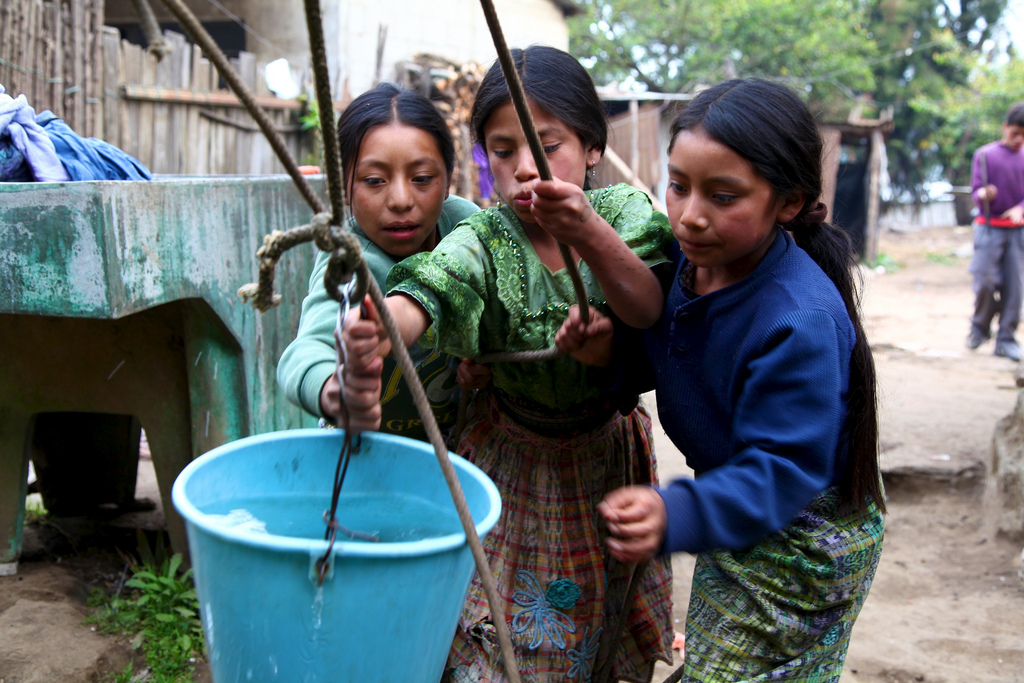 girls and water bucket