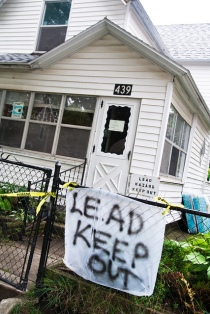 "house with ""lead keep out"" sign"