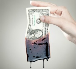 dollar bill dripping with oil