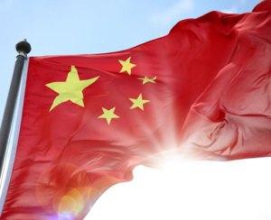 Chinese flag against sun