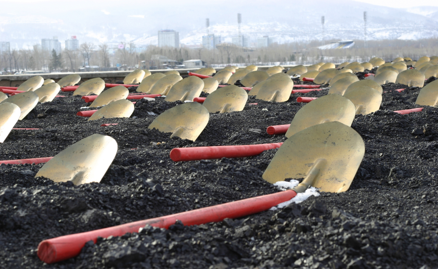 shovels laying on coal field