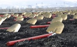 shovels laying on coal field