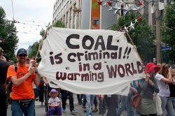 """coal protest banner: """"Coal is criminal in a warming world"""""""