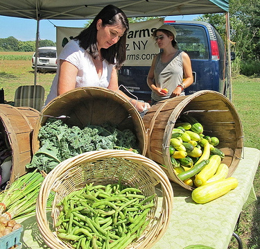 woman selling at farmers market