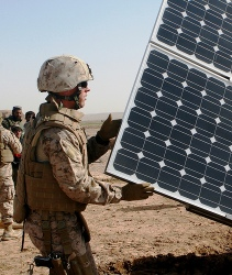 soldier with solar panel