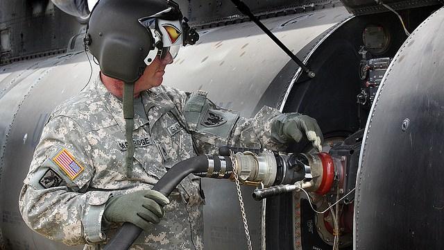 soldier filling tank