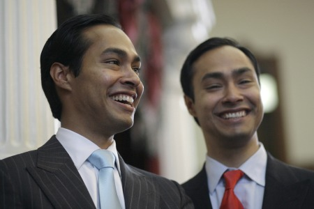 Julian Castro, left, mayor-elect of San Antonio, pauses during a visit with his brother, Rep. Joaquin Castro, D-San Antonio, right, in the Texas House of Representatives Wednesday, May 27, 2009, in Austin, Texas.