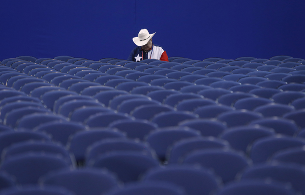 A delegate from Texas waits for the start of the session during the second day of the Republican National Convention in Tampa, Florida August 28, 2012.
