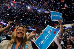 Delegates celebrate following remarks by U.S. President Barack Obama during the final session of the Democratic National Convention. Photo by Reuters / Jessica Rinaldi.
