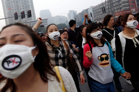 People shout slogans as they march during a protest against plans to expand a petrochemical plant in Ningbo, Zhejiang province October 28, 2012.